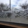 Custom design etched vinyl on glass window.